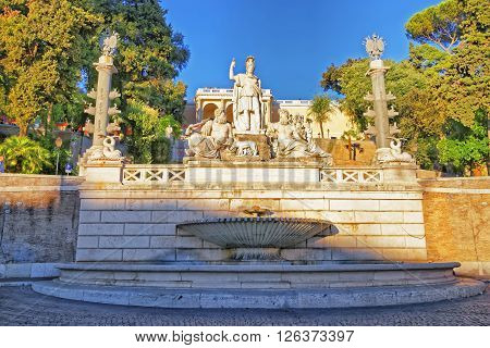 ROME ITALIA - AUGUST 27 2012: Rome between Tiber and Aniene Fountain in Piazza del Popolo in Rome in Italy. In the middle is she-wolf statue which is feeding Romulus and Remus