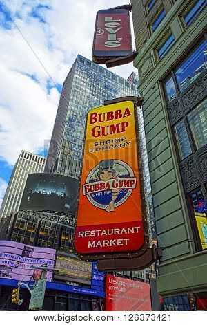 NEW YORK USA - APRIL 24 2015: Restaurants at Intersection of 7th Avenue and West 44th Street in Midtown Manhattan New York USA. It is Times Square an intersection between Broadway and 7th Avenue
