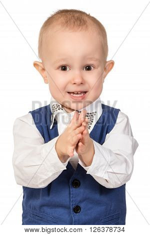 Portrait of a little boy in business suit, which is a fun claps his hands isolated on white background