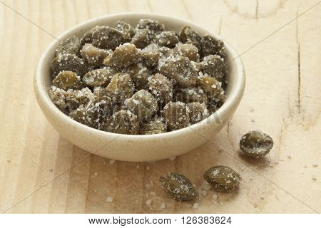 Salted capers on a dish