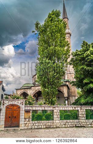 Famous street Bascarsija, viet at mosque, Sarajevo. Old city center. poster