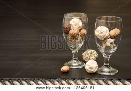 Textured balls in clear water goblets with nuts