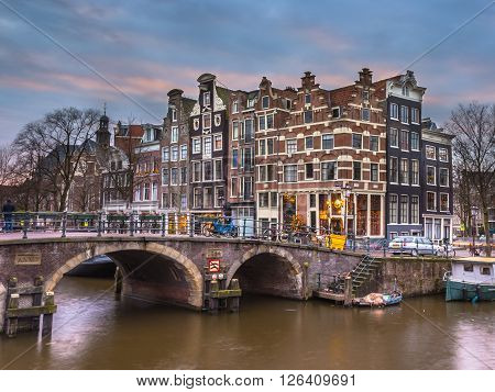 Canal Houses At Sunset In Amsterdam