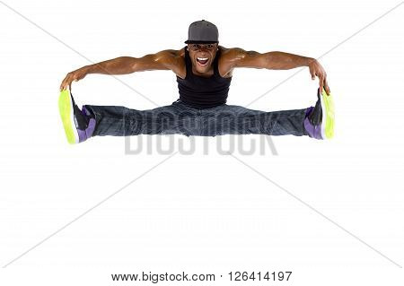 Hip hop dancer jumping or parkour freerunner on a white background
