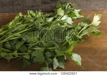Lovage plant on a vintage wooden background