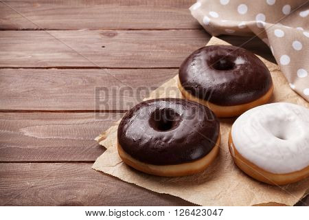 Donuts on wooden table. View with copy space