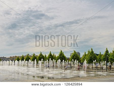 fountain about Pedestrian park Muzeon Arts. Moskow. Russia. people running in move