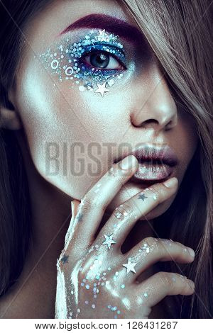 Art make up.Woman portrait with creative body-art. Art modern style. Blue eyes.