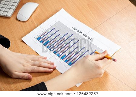 Picture of businesswoman hands with financial report
