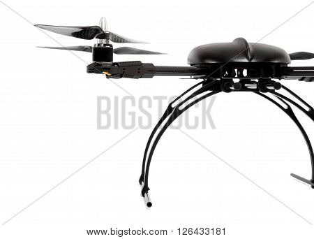 Picture of a black quadrocopter at studio