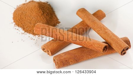 Picture of cinnamon spices on white plate