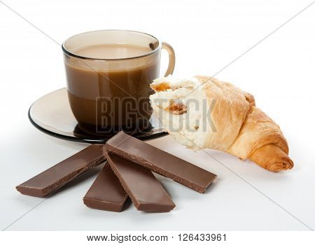 A cup of coffee cornetto and a four pieces of chocolate