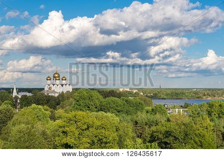 Russian summer landscape with a white chuch