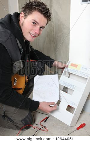 Laborer working on an electric meter