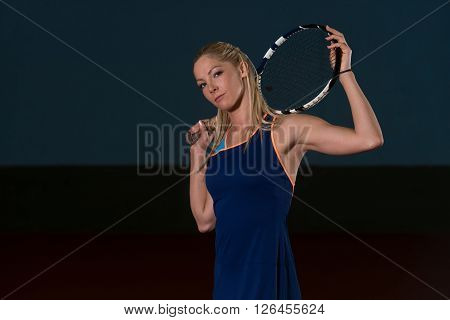 Woman Keeps Tennis Racket On Shoulders