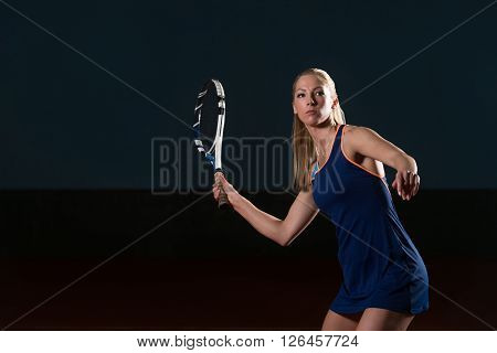 Tennis Player Hitting The Ball On Tennis Court