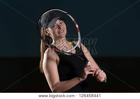 Young Attractive Woman Playing Tennis