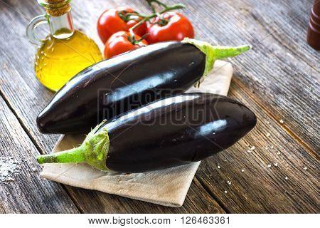 Eggplant On Vintage Wooden Background