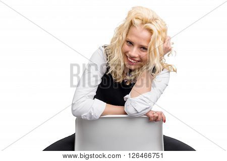 Flirty woman sitting on chair and smiling