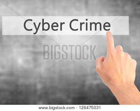 Cyber Crime - Hand Pressing A Button On Blurred Background Concept On Visual Screen.
