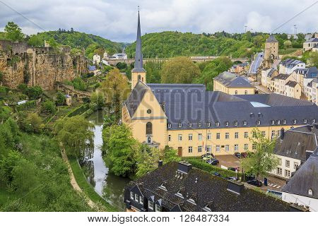 Luxembourg, Luxembourg - May 15: There are a church of St. Jean du Grung and ex-abbey of de Neumunster in the valley of the River Alzette May 15, 2013 in Luxembourg, Luxembourg.