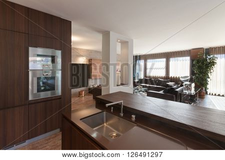 Interiors of new apartment, wooden kitchen modern design
