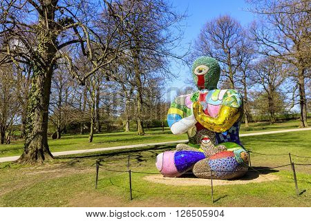 WAKEFIELD, YORKSHIRE, UK - APRIL 19: Buddha Sculpture by Niki de Saint Phalle exhibited at the Yorkshire Sculpture Park on April 19, 2016.