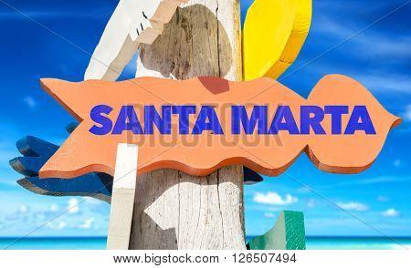 Santa Marta signpost with beach background