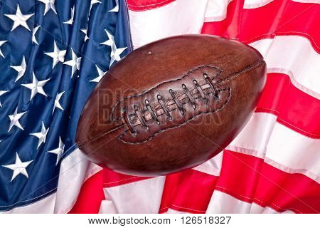 american football ball and old  glory flag
