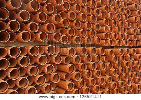 storage structure photograph of plastic pipes in orange