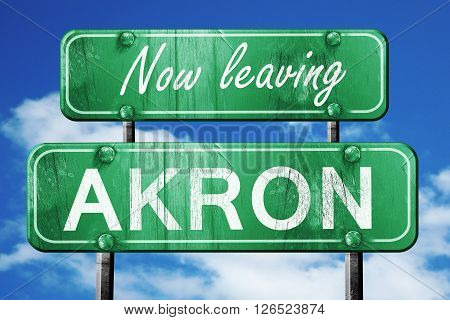 Now leaving akron road sign with blue sky
