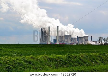 lignite fired power station behind a agricultural field landscape Niederaussem Germany issued in May 2007 by the WWF as the third-worst power station in Europe in terms of the relation of energy efficiency to CO2 emissions