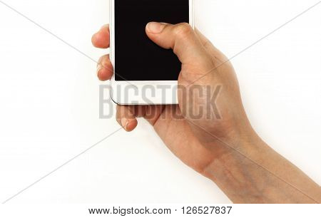 Hand holding mobile phone pressing with thumb on screen, solated