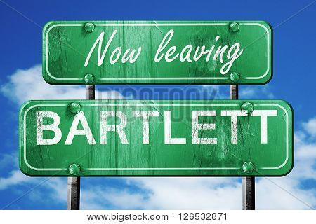 Now leaving bartlett road sign with blue sky
