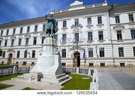 Statue of Lajos Kossuth and governmental building in Pecs Hungary.