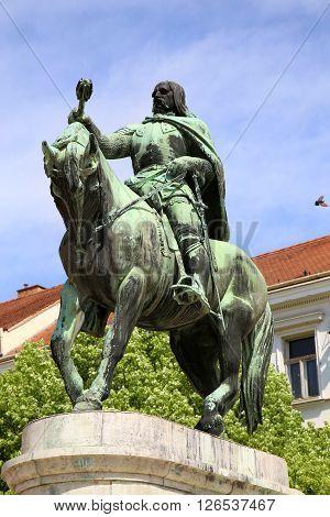 A statue of Janos Hunyadi on Szechenyi Square in Pecs Hungary poster