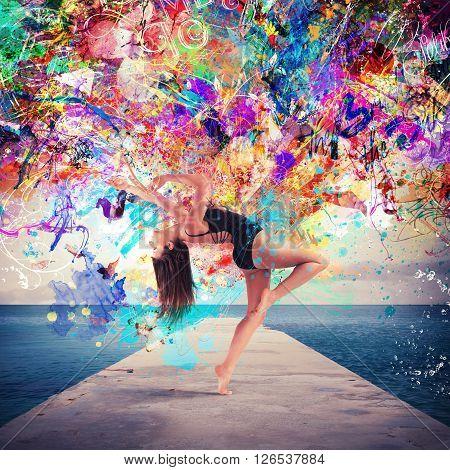 Woman dancer dancing in a sea pier