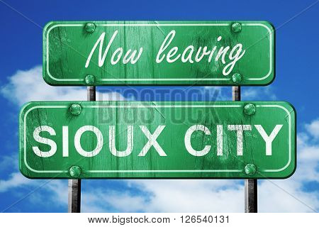Now leaving sioux city road sign with blue sky