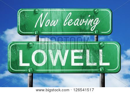 Now leaving lowell road sign with blue sky