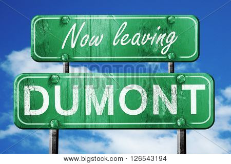 Now leaving dumont road sign with blue sky