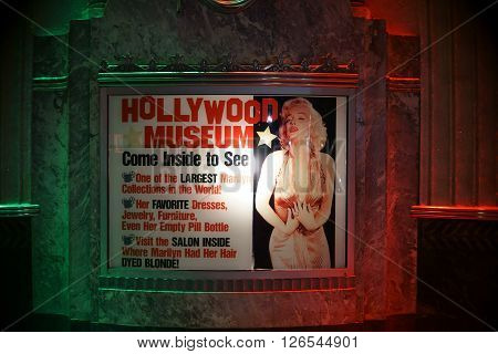 LOS ANGELES, UNITED STATES - DECEMBER 27: The night lit entrance sign of Hollywood Museum with a portrait of Marilyn Monroe on December 27 2015 Los Angeles.