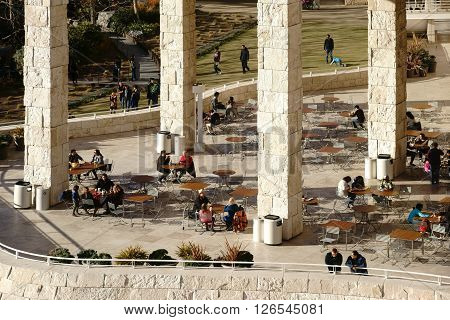 LOS ANGELES, UNITED STATES - DECEMBER 27: Museum visitors sit on an outside terrace of the Getty Center on tables and chairs in the cafe on December 27 2015 in Los Angeles.