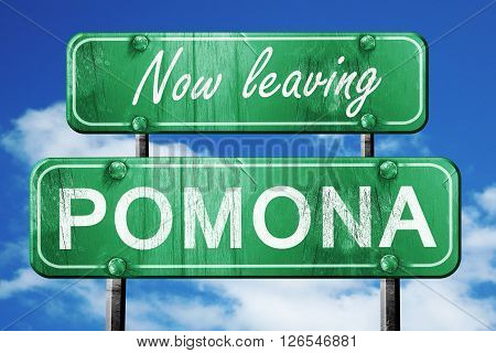 Now leaving pomona road sign with blue sky