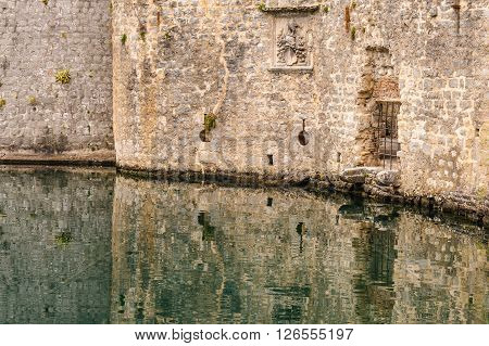 Kotor old town moat and defensive walls with loophole arrow slits