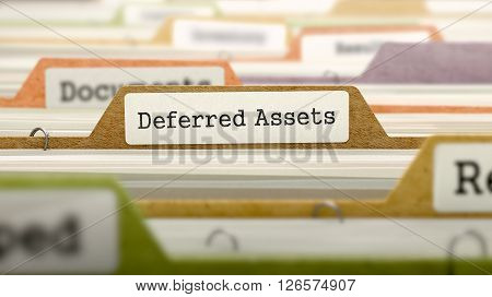 Deferred Assets Concept. Colored Document Folders Sorted for Catalog. Closeup View. Selective Focus. 3D Render.