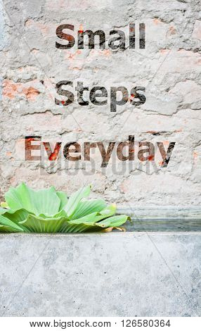 Small steps everyday inspirational quote, stock photo