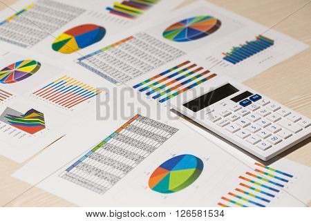 The image which is being analyzed using a chart and a culculator.
