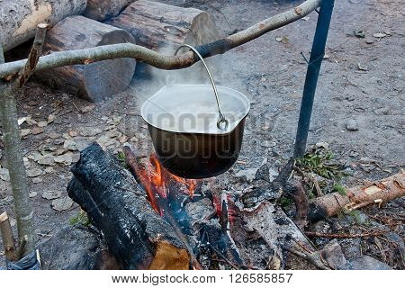 pot with a meal on a fire