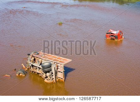 The Broken Truck Lies In Dirty Water