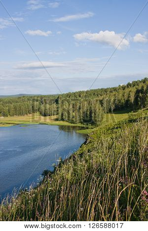 beautiful summer landscape on the river of a sunny summer day, Russia